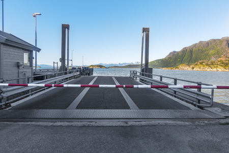 Empty Ferry terminal with metal ramp and cosed turnpike.  Norway.