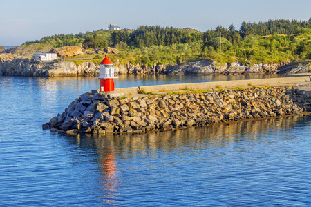 Small lighthouse at norwegian fjord on summer sunny day. Norway. Reklamní fotografie