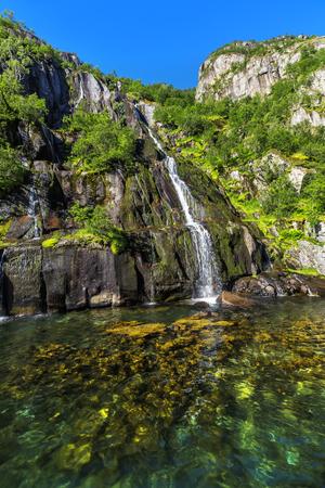 Waterfall Trollfjord (Trollfjorden) in the Lofoten Islands, Norway.