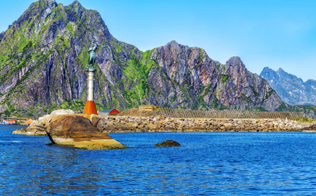 Svolvaer harbour with Statue of the Fisherman's wife and Racks Full Of Dried Codfish in the Lofoten Islands, Norway. Reklamní fotografie