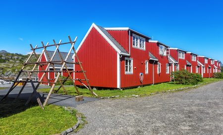 Racks for air-dried fish and houses of villagers, Svolvaer, Lofoten, Norway Reklamní fotografie