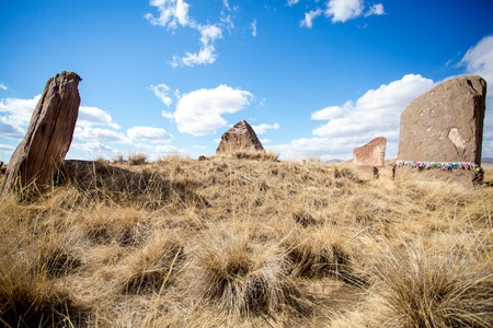 tumulus: Salbyksky burial mound created in the 4th century B.C. Vertical stone plates situated around the tumulus. Stock Photo
