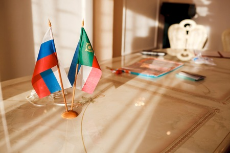 registrar: Russia Flag and the Republic of Khakassia on the table in a registry office. Marriage registration.