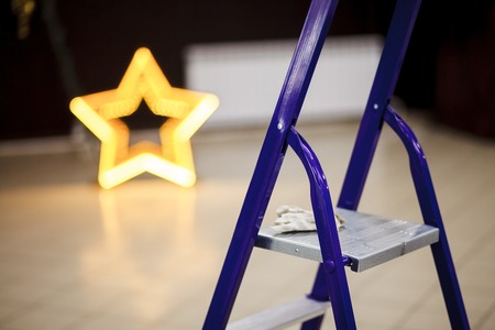 scaling ladder: Step ladder closeup, decorating the banquet hall of the event.