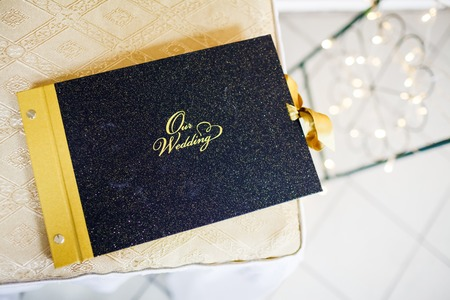 wedding photo album: Our wedding photo album decorated with gold, a photographic story of the day.
