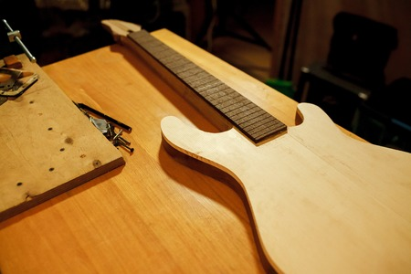 billet: Billet of wood for bass guitar. Manufacture and repair of musical instruments. Installing the guitar frets.