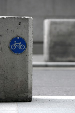 Blue cycle path sign on concrete block Stock Photo
