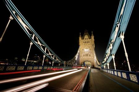 Light trails at night across Tower Bridge, London