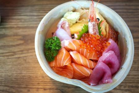 botan: Chirashi sushi bowl with salmon, tuna, shrimp, salmon roe, eel, sea bass, sweet omelette and imitation crab meat served with wasabi