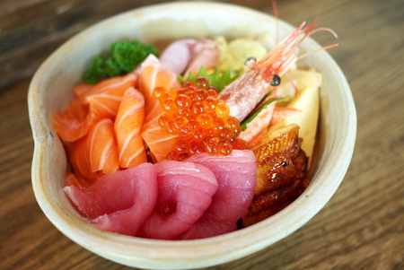 botan: Chirashi sushi bowl with salmon, tuna, shrimp, salmon roe, eel, sea bass, sweet omelette and imitation crab meat served with wasabi