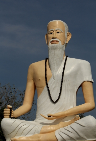 Brahma statue clad in white cloth. photo