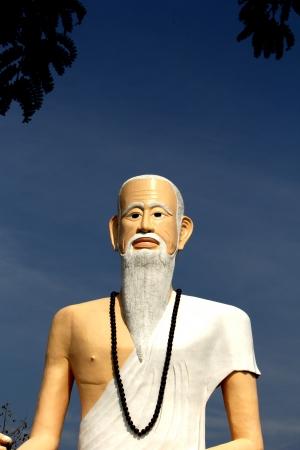 shree: Brahma statue clad in white cloth.
