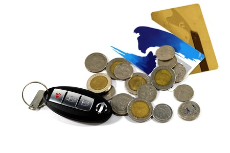bank accounts: Car key with money. And bank accounts separate on white. Stock Photo