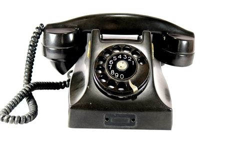 Ancient black phone  on a white background photo