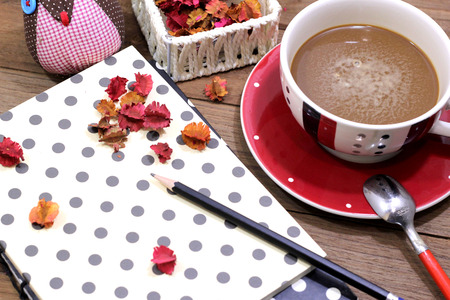 Coffee vintage table top. A book, pencil and dried flower - picture style vintage effect photo