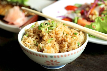 fragrant: fried rice with garlic in a white cup. style Japanese food. Stock Photo