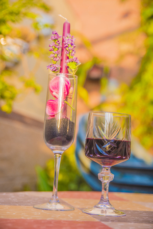 glass of wine in a flowered garden with colorful spring