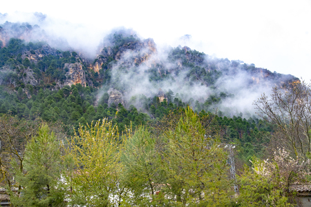 Sierra del Segura, Albacete, Spain Clouds,  on a rainy and cold spring day that is late the arrival of good weather