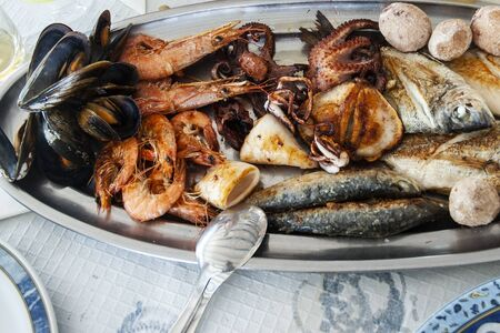 Exquisite Mediterranean fish fountain ready to savor on a summer morning 写真素材