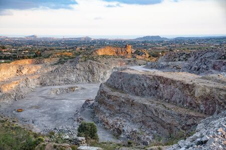 Urban planning, primary industry and nature Deep and extensive outdoor excavation in a stone quarry exploited outdoors.