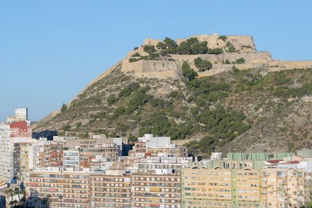 View of the west façade of the Castillo de San Barbara in Alicante, with a view of the city below