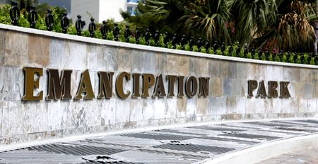 �mancipation: Kingston, Jamaica - December 20, 2009 - The Emancipation Park sign on a wall.