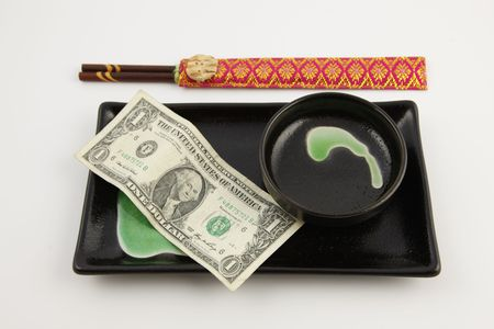One United States dollar bill on a sushi plate with chopsticks Stock Photo - 6502429