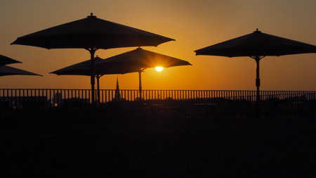 parasols: Silhouettes of parasols at sunset in Luebeck