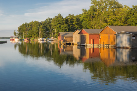 mecklenburg western pomerania: Boathouses at the mouth of river Elde to lake Plau, Mecklenburg-Western Pomerania