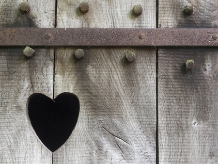 outhouse: Heart carved in wood Stock Photo