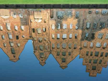 Mirroring of the salt storages of Luebeck, Germany, in water