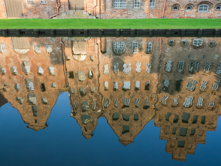Mirroring of the salt storages of Luebeck, Germany, in water;