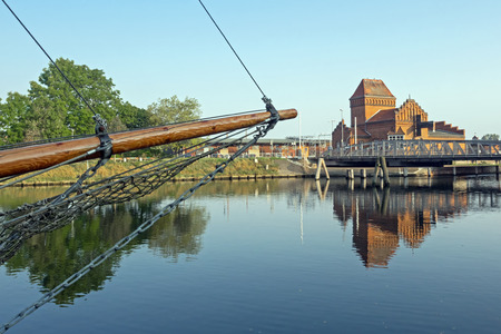 Swing bridge of Luebeck with bow of a sailing boat at the foreground Stock Photo
