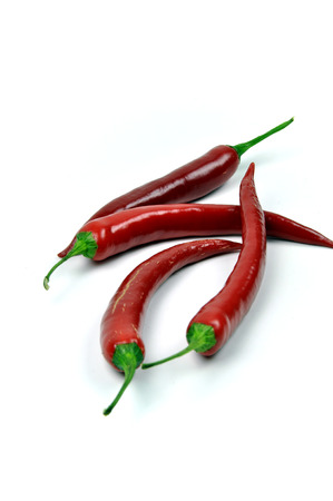 pungency: Four red chili isolated on white background