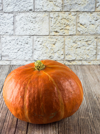 closeup of a pumpkin on wooden background Stock Photo