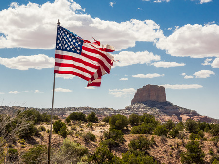 Landscape of Arizona, United States, with flag in the foreground