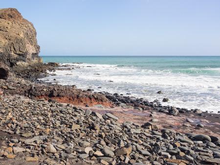 Stony beach at the coast of the Atlantic Ocean at Fuerteventura, Canary Islands