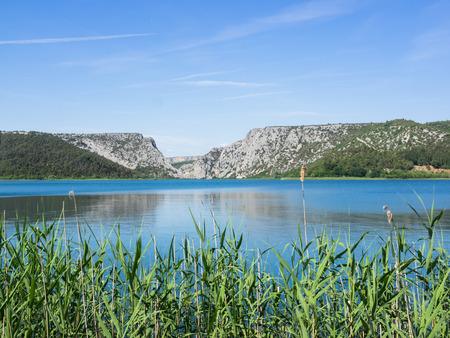Landscape with river Krka and mountains at Krka National Park near Sibenik, Crotia
