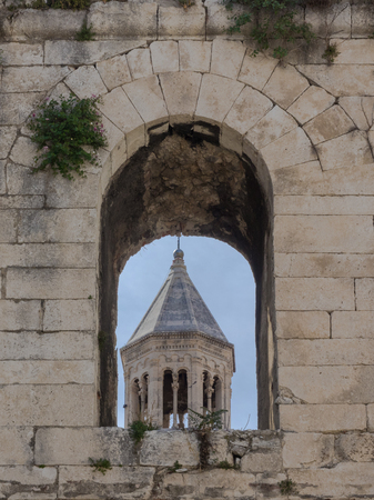 sacral: World heritage Diocletians palace at Split, Croatia. View through an arch of the town wall to the catherdal of St. Domnius