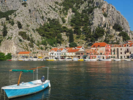 starigrad: Skyline of Omis with boat in the foreground, Croatia