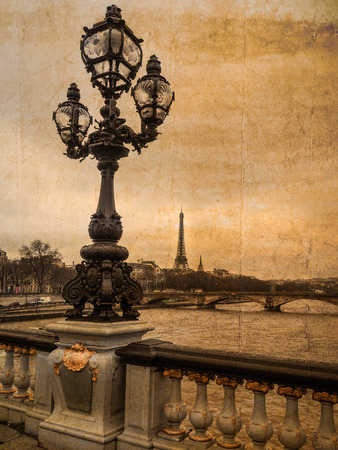 Postcard of Paris style in retro: View from bridge Alexandre III with candelabra in the foreground and Eiffel tower in the background; copyspace