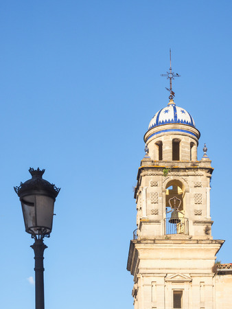Tower of the cathedral of Jerez de la Frontera with street lamp in front of blue sky Stock Photo