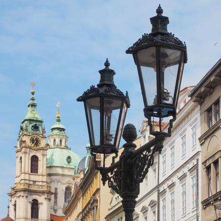 quadratic: Church St. Nicholas in Prague, Czech Republic, with street lamp in the foreground