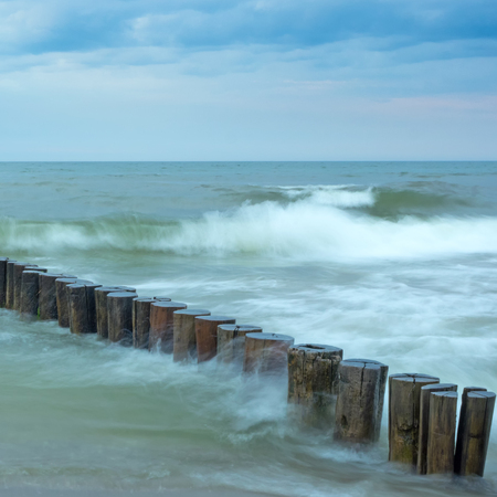 groynes: Image with time exposure of waves at breakwaters in the Baltic Sea
