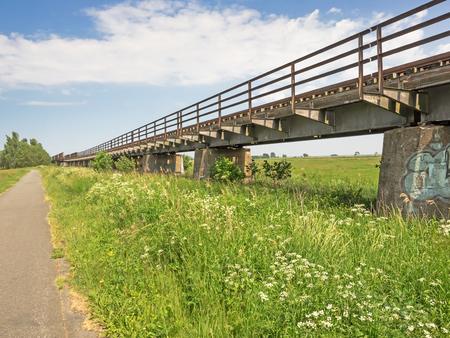 Abandoned railway bridge in the landscape of Mecklenburg-Western Pomerania, Germany Stock Photo