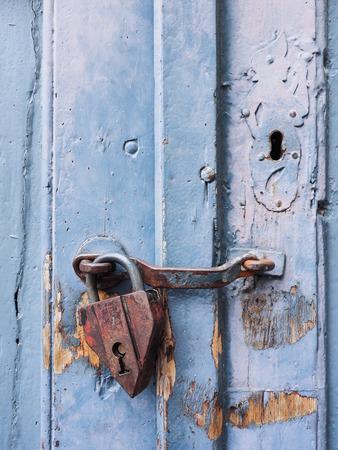 Padlock at blue door