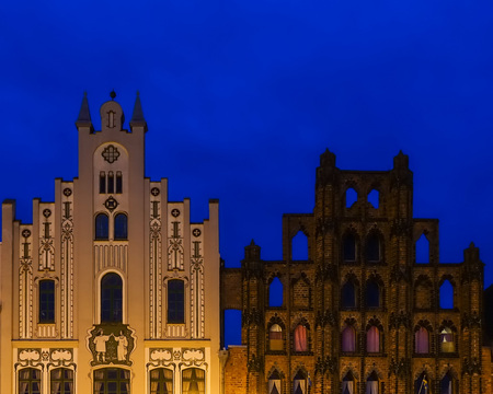 Gables of two historical buildings in Wismar at blue hour