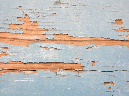 Wood with blue paint flaking off to use as background 写真素材