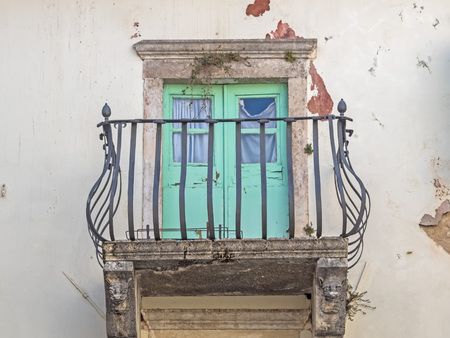 Balcony with iron balustrade at an old house in Croatia