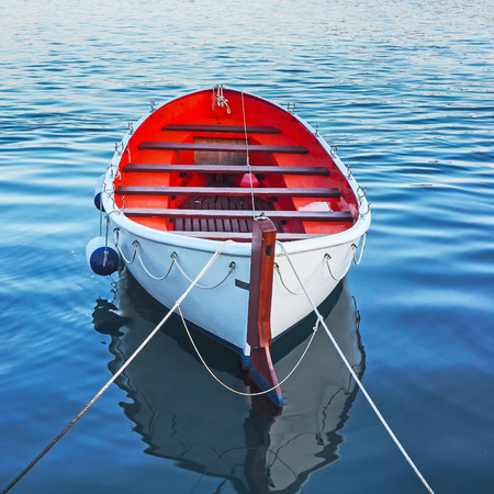 Empty rowboat in the water